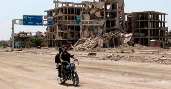 Серьезный пожар наскладе оружия вСирии: склады могла штурмовать авиация